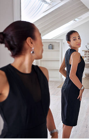 Woman looking at mirror of herself